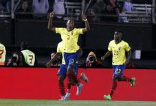 Ecuador's Frickson Erazo (front) celebrates after scoring a goal during their 2018 World Cup qualifying soccer match against Argentina at the Antonio Vespucio Liberti stadium in Buenos Aires, Argentina, October 8, 2015.  REUTERS/Enrique Marcarian