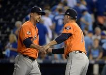 Oct 8, 2015; Kansas City, MO, USA; Houston Astros relief pitcher Luke Gregerson (left) celebrates with manager A.J. Hinch (14) after defeating the Kansas City Royals in game one of the ALDS at Kauffman Stadium. John Rieger-USA TODAY Sports