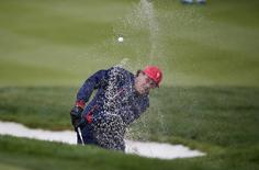 U.S. team Phil Mickelson hits out of a bunker on the first hole during their singles matches of the 2015 Presidents Cup golf tournament at the Jack Nicklaus Golf Club in Incheon, South Korea, October 11, 2015.  REUTERS/Kim Hong-Ji