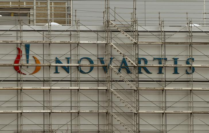 Swiss drugmaker Novartis' logo is seen behind scaffolding at the company's plant in the northern Swiss town of Stein January 27, 2015. REUTERS/Arnd Wiegmann