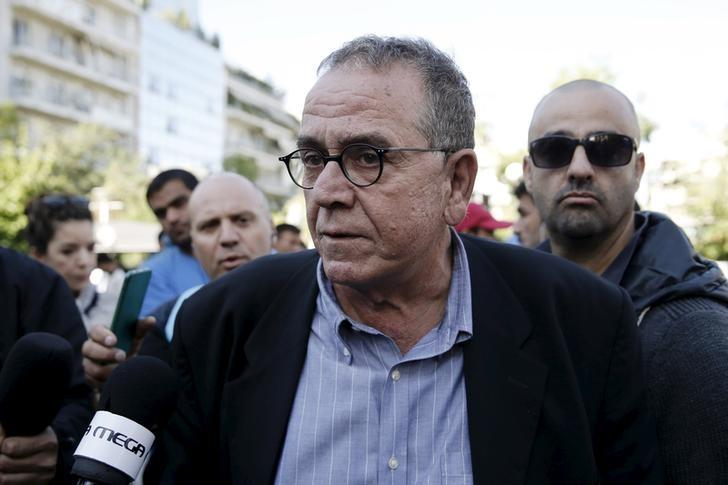 Greek Migration Minister Yannis Mouzalas talks to the media at central Athens's Victoria Square, where many refugees and migrants had set up following their arrival in Athens, Greece, October 1, 2015. REUTERS/Alkis Konstantinidis