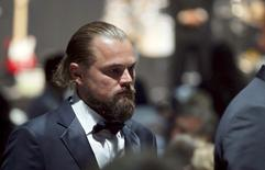 U.S actor Leonardo DiCaprio walks during an auction at the amfAR's Cinema Against AIDS 2015 event during the 68th Cannes Film Festival in Antibes, near Cannes, southern France, May 21, 2015. REUTERS/ Regis Duvignau    - RTX1E1EZ