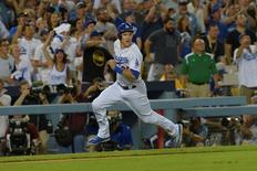 Oct 10, 2015; Los Angeles, CA, USA; Los Angeles Dodgers second baseman Chase Utley (26) scores on a two-RBI double by first baseman Adrian Gonzalez (not pictured) against the New York Mets during the seventh inning in game two of the NLDS at Dodger Stadium. Mandatory Credit: Jayne Kamin-Oncea-USA TODAY Sports