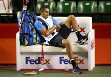 Nick Kyrgios of Australia sits on the bench during his men's singles tennis match against Benoit Paire of France at the Japan Open championships in Tokyo October 9, 2015.   REUTERS/Thomas Peter