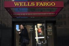 A woman exits a Wells Fargo ATM in the Manhattan borough of New York, October 10, 2015.  REUTERS/Eduardo Munoz -