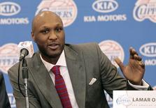 Basketball player Lamar Odom speaks at a news conference announcing his acquisition by the Los Angeles Clippers in Los Angeles, California July 2, 2012. REUTERS/Mario Anzuoni