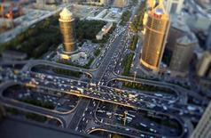 Vehicles drive on the Guomao Bridge during the evening rush hour in Beijing, September 3, 2014. REUTERS/Jason Lee