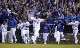 Oct 14, 2015; Kansas City, MO, USA; Kansas City Royals designated hitter Kendrys Morales (25) leads his team to the field as they celebrate defeating the Houston Astros in game five of the ALDS at Kauffman Stadium. Mandatory Credit: John Rieger-USA TODAY Sports