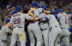October 15, 2015; Los Angeles, CA, USA; New York Mets celebrate the 3-2 victory against Los Angeles Dodgers in game five of NLDS at Dodger Stadium. Mandatory Credit: Jayne Kamin-Oncea-USA TODAY Sports