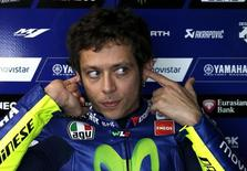 Yamaha MotoGP rider Valentino Rossi of Italy blocks his ears during free practice 1 before the Australian Grand Prix on Phillip Island October 16, 2015. REUTERS/Brandon Malone