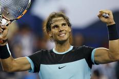 Rafael Nadal of Spain celebrates after winning his men's singles quarter-final match against Stan Wawrinka of Switzerland at the Shanghai Masters tennis tournament in Shanghai, China, October 16, 2015. REUTERS/Aly Song