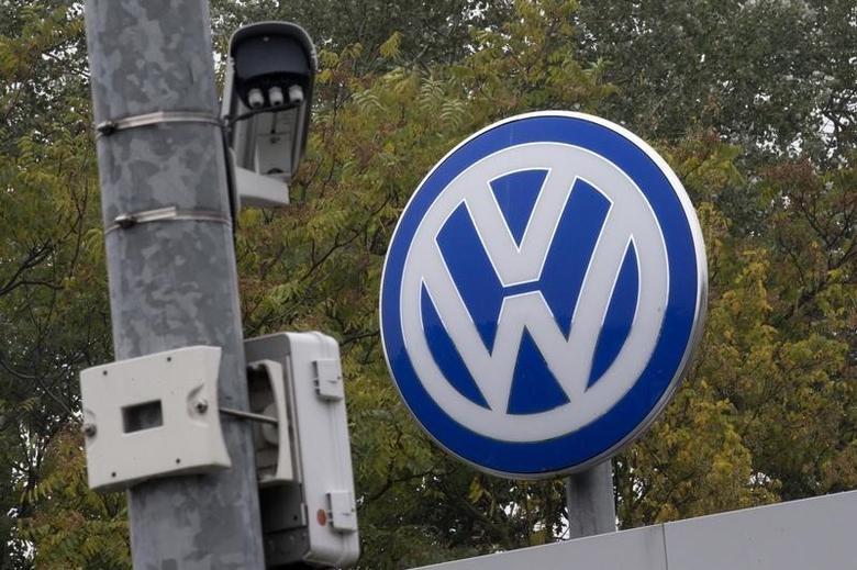 A Volkswagen logo stands next to a CCTV security camera in Wolfsburg, Germany October 7, 2015.   REUTERS/Axel Schmidt