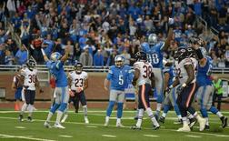 Detroit Lions kicker Matt Prater (5) celebrates with teammates Sam Martin (6) and Devin Taylor (98) after kicking a 26-yard field goal in overtime of a 37-34 victory against the Chicago Bears in a NFL game at Ford Field. Mandatory Credit: Kirby Lee-USA TODAY Sports