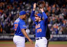 New York Mets second baseman Daniel Murphy (right) celebrates with relief pitcher Jeurys Familia after defeating the Chicago Cubs in game two of the NLCS at Citi Field. Mandatory Credit: Robert Deutsch-USA TODAY Sports