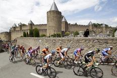 A pack of riders cycles past Carcassonne' castle during the 15th stage of the Tour de France 2011 cycling race from Limoux to Montpellier July 17, 2011. REUTERS/Stefano Rellandini