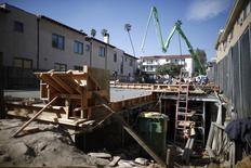 People work on a construction site to build a new apartment building in Los Angeles, California February 6, 2015. REUTERS/Lucy Nicholson