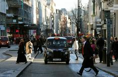 A taxi travels along Oxford Street during a bus strike in London in this file photograph dated January 13, 2015. REUTERS/Suzanne Plunkett/files