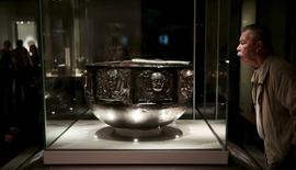 "A visitor looks at The Gundestrup cauldron displayed in the ""Celts: art and identity"" exhibition at the British Museum in London, Britain in this September 23, 2015 file photo. REUTERS/Suzanne Plunkett/Files"