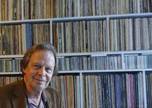 Veteran music producer Joe Boyd poses in front of his vintage record collection in London, October 20, 2015. REUTERS/Jeremy Gaunt