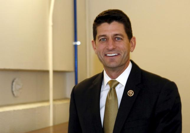 U.S. Representative Paul Ryan (R-WI) smiles as he walks at the end of the day of the House Freedom Caucus meeting on Capitol Hill in Washington October 21, 2015. REUTERS/Yuri Gripas SAP is the sponsor of this coverage which is independently produced by the staff of Reuters News Agency.