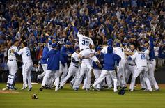Kansas City Royals players celebrate on the field after defeating the Toronto Blue Jays in game six of the ALCS at Kauffman Stadium. Peter G. Aiken-USA TODAY Sports