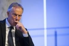 Former British Prime Minister Tony Blair listens to a question during an appearance at the 9/11 Memorial Museum in New York October 6, 2015. REUTERS/Brendan