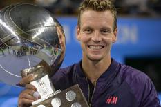 Tomas Berdych of Czech Republic smiles as he holds his trophy after winning the finals against Jack Sock of the U.S. during their Stockholm Open tennis tournament final match in Stockholm, Sweden October 25, 2015. REUTERS/Anders Wiklund/TT News Agency