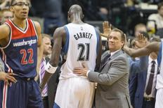 Minnesota Timberwolves head coach Flip Saunders pats Minnesota Timberwolves forward Kevin Garnett (21) on the back in the second half against the Washington Wizards at Target Center. The Timberwolves won 97-77. Mandatory Credit: Jesse Johnson-USA TODAY Sports