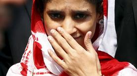 Geeta gestures as she comes out from an airport after her arrival in New Delhi, India, October 26, 2015. REUTERS/Adnan Abidi
