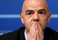 UEFA general secretary Gianni Infantino pauses during a news conference on behalf of their suspended president Michel Platini following a meeting of UEFA's executive committee at the UEFA headquarters in Nyon, Switzerland, October 15, 2015.  REUTERS/Denis Balibouse