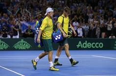 Tennis - Great Britain v Australia - Davis Cup Semi Final - Emirates Arena, Glasgow, Scotland - 19/9/15 Men's Doubles - Australia's Lleyton Hewitt and Sam Groth look dejected after losing their match Action Images via Reuters / Jason Cairnduff