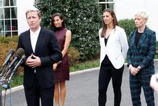 Oct 27, 2015; Washington, DC, USA; (L-R) Team USA forward Abby Wambach speaks with the media at the stakeout position outside the West Wing as Team USA forward Christen Press, Team USA midfielder Carli Lloyd, and Team USA midfielder Megan Rapinoe listen after a ceremony honoring the 2015 Women's World Cup champion U.S. Women's National Soccer Team at The White House. Mandatory Credit: Geoff Burke-USA TODAY Sports