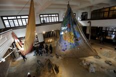 "Visitors look at Anna Boghiguian's work ""The Salt Traders"" at the 14th Istanbul Biennial at Galata Greek Primary School in Istanbul, Turkey, October 28, 2015.  REUTERS/Murad Sezer"