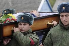 ATTENTION EDITORS - VISUAL COVERAGE OF SCENES OF INJURY OR DEATH  Russian servicemen carry the coffin of Vadim Kostenko, one of the Russian air force's support staff in Syria, during his funeral in the village of Grechnaya Balka, north-west of Krasnodar, Russia October 28, 2015. The body of the first Russian soldier to die in Syria was returned to his parents with wounds inconsistent with the official version that he hanged himself, the serviceman's uncle told a Russian newspaper on Wednesday. Kostenko, 19, on Tuesday became the first Russian serviceman to be confirmed dead in four weeks of air strikes there. The ministry of defence said he hanged himself because of problems in his personal life. REUTERS/Stringer TEMPLATE OUT - RTX1TMFY