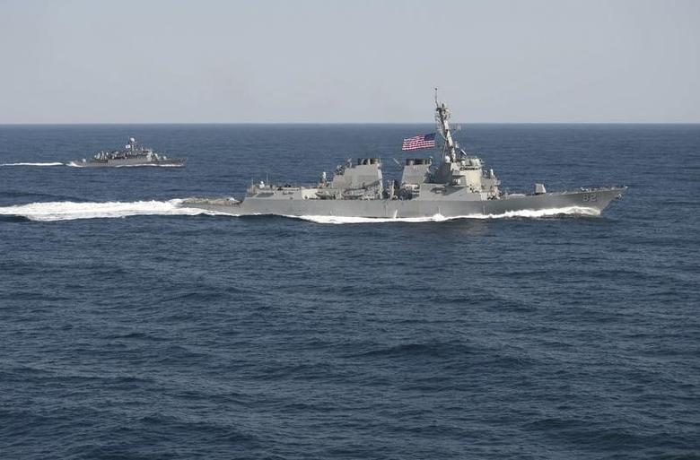 USS Lassen (DDG 82), (R) transits in formation with ROKS Sokcho (PCC 778) during exercise Foal Eagle 2015, in waters east of the Korean Peninsula, in this March 12, 2015, handout photo provided by the U.S. Navy.  REUTERS/U.S. Navy/Mass Communication Specialist 1st Class Martin Wright/Handout via Reuters
