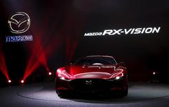 Mazda Motor Corp's RX-Vision is revealed during a presentation at the 44th Tokyo Motor Show in Tokyo, Japan, October 28, 2015. REUTERS/Yuya Shino