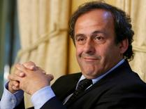 Michel Platini smiles during a news conference at the Geneva Press Club in Geneva, Switzerland, in this April 29, 2008 file photo. REUTERS/Denis Balibouse/Files
