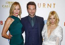 "Cast members (L-R) Uma Thurman, Bradley Cooper, and Sienna Miller arrive for the premiere of the film ""Burnt"" in New York October 20, 2015. REUTERS/Lucas Jackson"