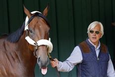 May 13, 2015; Baltimore, MD, USA; Horse trainer Bob Baffert walks American Pharaoh inside the Preakness Barn after arriving for the 140th Preakness Stakes at Pimlico Race Course. Mandatory Credit: Geoff Burke-USA TODAY Sports