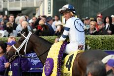 Oct 30, 2015; Lexington, KY, USA;  Javier Castellano aboard Stopchargingmaria is led to the winners circle after race nine of the 2015 Breeders Cup Championships at Keeneland. Mandatory Credit: Richard Mackson-USA TODAY Sports