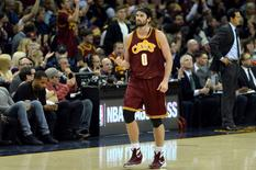 Cleveland Cavaliers forward Kevin Love (0) pumps his fist after an assist during the third quarter against the Miami Heat at Quicken Loans Arena. Ken Blaze-USA TODAY Sports