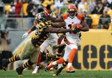 Cincinnati Bengals wide receiver Brandon Tate (19) runs the ball past Pittsburgh Steelers linebacker Vince Williams (98) during the second half at Heinz Field. The Bengals won the game 16-10. Mandatory Credit: Jason Bridge-USA TODAY Sports