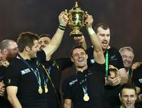 Captain Richie McCaw of New Zealand (L) and Dan Carter hold up the Webb Ellis Cup after winning the Rugby World Cup Final against Australia at Twickenham in London, October 31, 2015.  REUTERS/Toby Melville