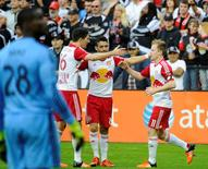 Nov 1, 2015; Washington, DC, USA; New York Red Bulls midfielder Dax McCarty (11) celebrates with midfielder Sacha Kljestan (16), and midfielder Felipe Martins (8) after scoring a goal against D.C. United during the second half at Robert F. Kennedy Memorial. The Red Bulls won the first leg of the Eastern Conference semi-finals 1-0. Mandatory Credit: Brad Mills-USA TODAY Sports