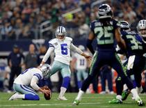 Nov 1, 2015; Arlington, TX, USA; Dallas Cowboys kicker Dan Bailey (5) kicks a field goal during the game against the Seattle Seahawks at AT&T Stadium. Kevin Jairaj-USA TODAY Sports