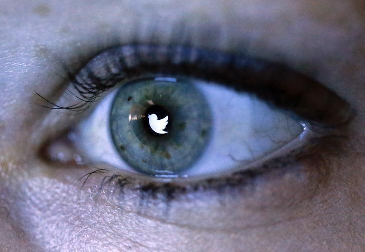 An illustration picture shows the Twitter logo reflected in the eye of a woman in Berlin, November 7, 2013. REUTERS/Fabrizio Bensch