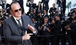 Director Quentin Tarantino poses on the red carpet as he arrives at the closing ceremony of the 67th Cannes Film Festival in Cannes May 24, 2014. REUTERS/Regis Duvignau/Files