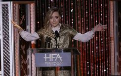 "Actress Saoirse Ronan accepts the New Hollywood Award for her role in the film ""Brooklyn"" at the Hollywood Film Awards in Beverly Hills, California November 1, 2015.  REUTERS/Mario Anzuoni"