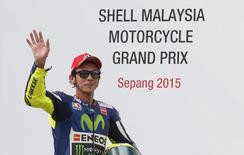 Yamaha MotoGP rider Valentino Rossi of Italy waves after placing third in the Malaysian Motorcycle Grand Prix at Sepang International Circuit near Kuala Lumpur, Malaysia, October 25, 2015. REUTERS/Olivia Harris