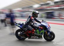 Yamaha MotoGP rider Jorge Lorenzo of Spain leaves the garage before the qualifying round of the Malaysian Motorcycle Grand Prix at Sepang International Circuit near Kuala Lumpur, Malaysia, October 24, 2015. REUTERS/Olivia Harris